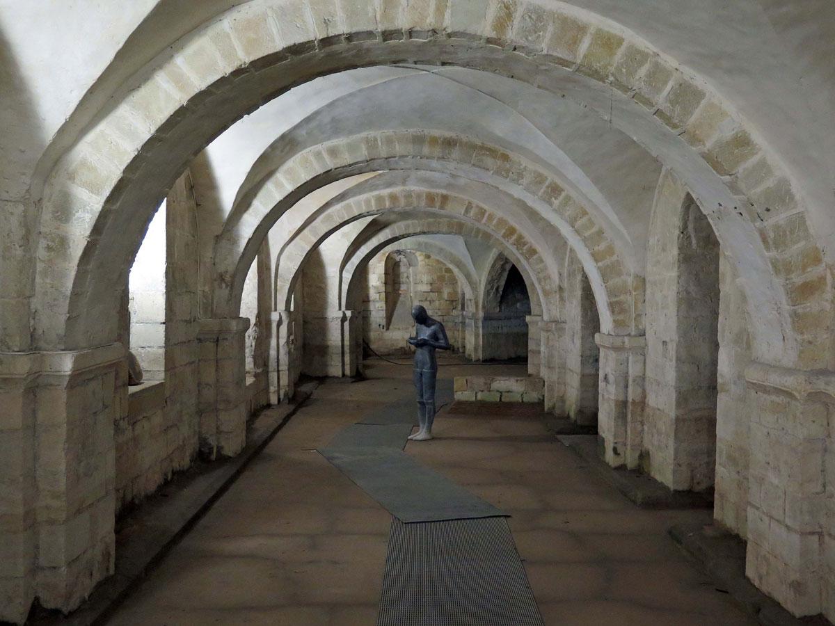 "The Crypt with Antony Gormley's ""Sound II"" Statue"