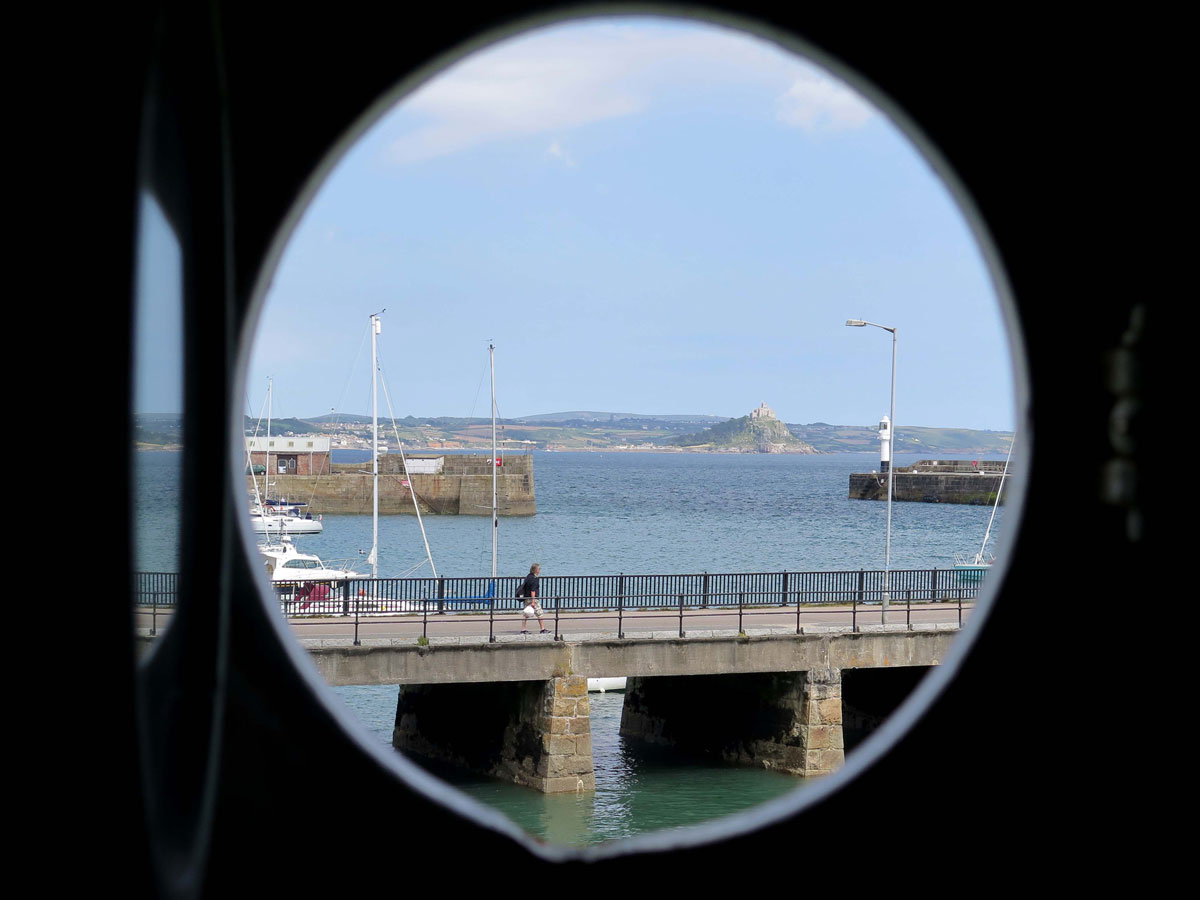 St Michael's Mount through a porthole in the Ship Ashore